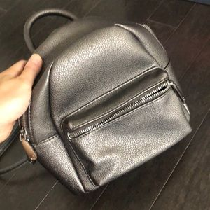 Brand new without tags, pewter mini backpack